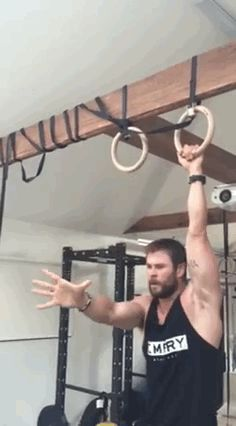 "Chris Hemsworth Throws Shade At ""Captain America"" While Doing Pull-Ups And It's Magical"