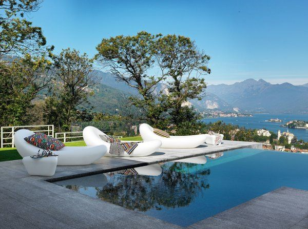 The Petal chaise lounges and table. Tagged: Outdoor, Wood Patio, Porch, Deck, Back Yard, Infinity Pools, Tubs, Shower, and Small Pools, Tubs, Shower.  Photo 3 of 60 in Best Outdoor Infinity Photos from Patterns for the Outdoors by Missoni Home