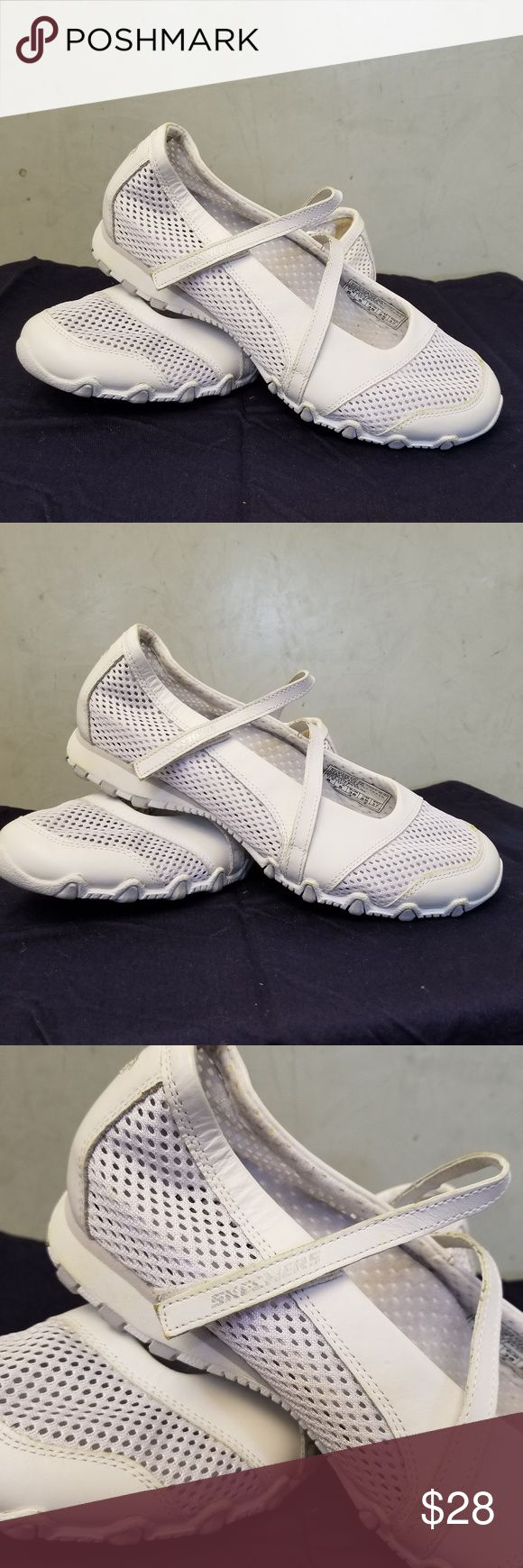 Skechers white sneakers NWOT brand new without tags white Skechers sneaker shes. has a little yellowing on the feel part shown in pic 4 Skechers Shoes Sneakers
