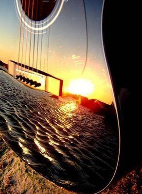 What a great picture of a sunset reflected in a guitar.