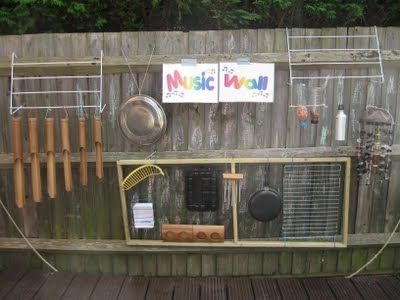 """Another great music wall, from the Pre-school Play blog. Visit the blog to see lots more pictures including children getting creative and adding to the wall, plus an excellent description of how it was made and how the children use it. Love the creative use of sections of clothes dryer for hanging the instruments, and there's an interesting mix of found objects and """"real"""" instruments."""