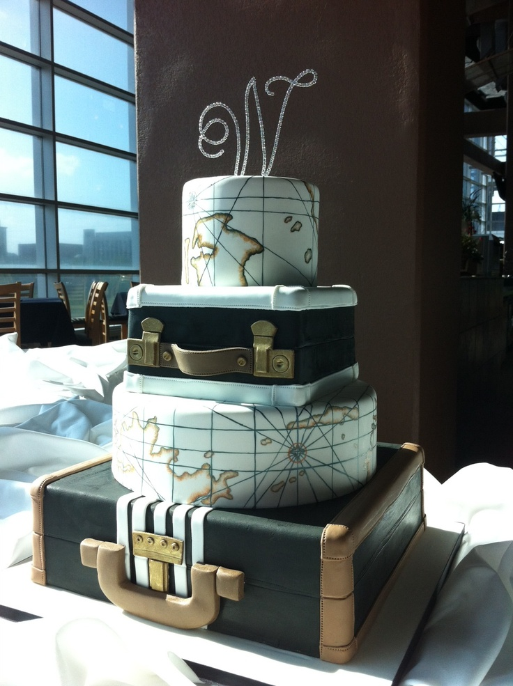 World Traveler Wedding Cake by Renay Zamora @ Sweetface Cakes.  Vintage suitcases & hand-painted antique nautical maps.  Picture taken at LP Field in Nashville, TN.