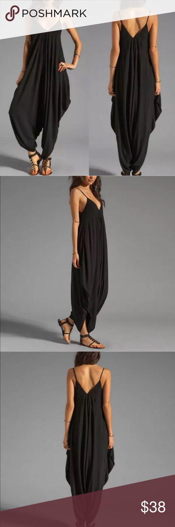 ELEGANT BLACK HAREM JUMPSUIT ✔️ Flowy legged Jumpsuit!! SUPER classy and elegant. Plus super comfortable!! ✔️ ••••PRICE IS FIRM UNLESS BUNDLED•••• Limited availability Pants Jumpsuits & Rompers
