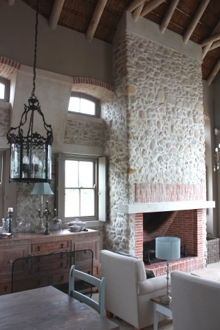 love this double volume room and fireplace made with lanes ceramics klompie bricks