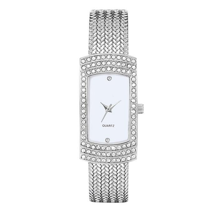 """For the classic woman who thrives in simplicity while still appreciating the finer things in life.FEATURES• Band is 9"""" L x 9/16"""" W• Mesh strap• Rectangular-shaped face• Mother-of-pearl dial• Rhinestone at the 6 and 12 o'clock marks• Rhinestone-covered bezelMATERIALS• Silvertone metal• Stainless steelImported"""