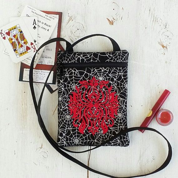 I have some really talented friends. See this listing at https://www.etsy.com/listing/477567341/red-spider-on-crossbody-bag-gothic