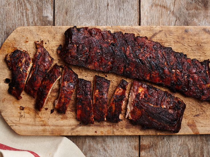 Smoked Baby Back Ribs Recipe : Food Network. These cook low and slow and require a smoker box. Google how to do that on a charcoal grill. They also call for marinating time and a lot of woodchips. Time consuming, but would be worth it.