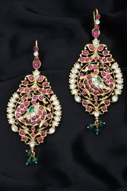 Temple style earrings with cabochon rubies and diamond and emerald accents by C Krishnaiah Chetty.