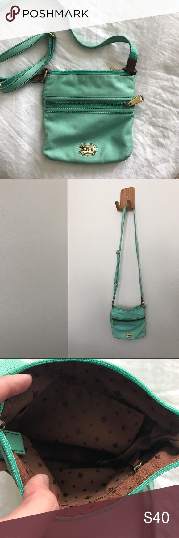 Teal over-the-shoulder fossil bag Small, bright teal fossil bag that easily slings over the shoulder is sure to add a bit of style to your every day! Worn less than 10 times. Fossil Bags Shoulder Bags