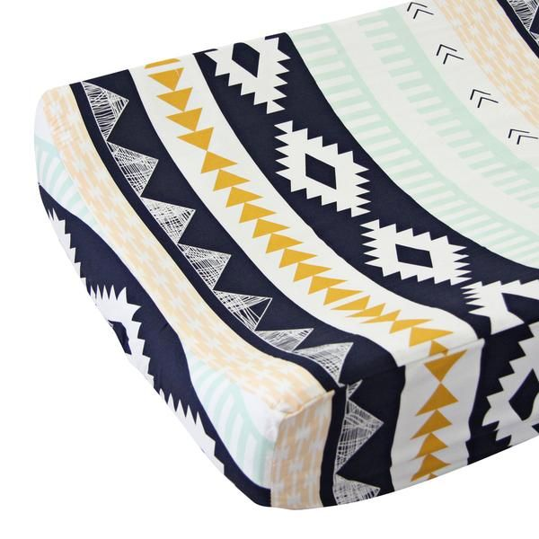 Complete the look of your trendy tribal inspired nursery with our Aztec Gold and Mint changing pad cover.