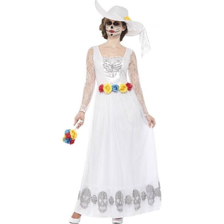 Deze Day of the dead bruidsjurk met skelet opdruk en aangehechte bloemen riem is gemaakt van polyester en wordt geleverd met een hoed en bruidsboeket. Wasvoorschrift: Afnemen met vochtige doek of stomen.