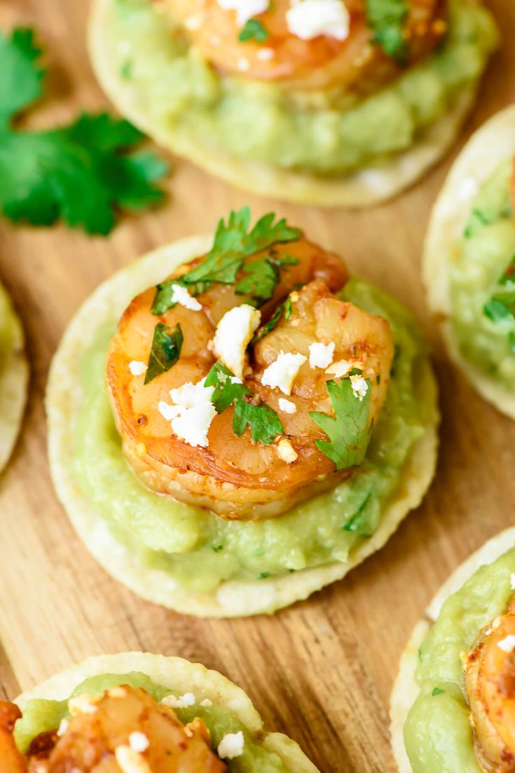 Spicy Shrimp Guacamole Bites   Juicy shrimp and spicy guacamole on top of a crunchy toritlla chip  So EASY and everyone loves this appetizer recipe