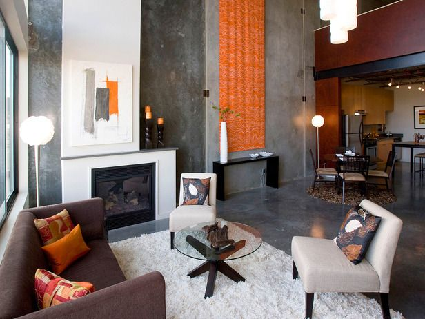 Contemporary  This contemporary living room pulls in current trends for a look that can hold up even when the styles change. Industrial elements and urban surroundings combine with bold orange hues and white accents for a… mo