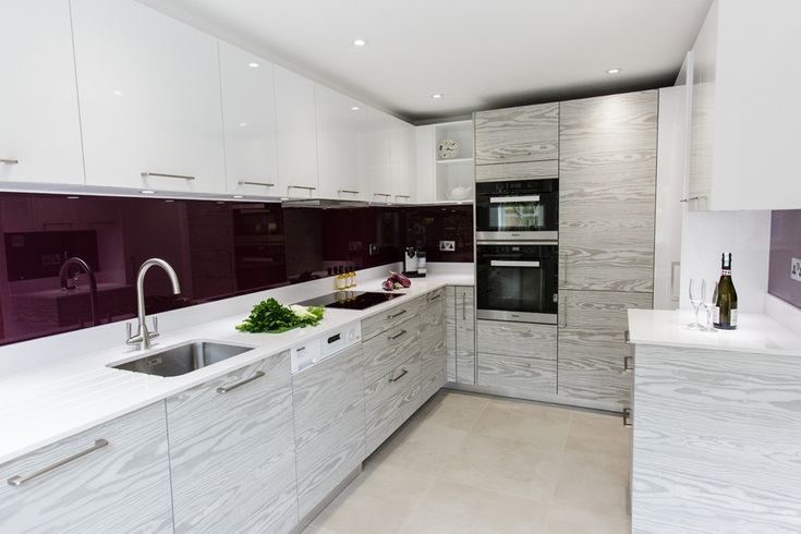 Smaller spaces can be particularly suited to contemporary design. To create a fluid and uncrowded small kitchen, minimal definition handleless doors are the best solution. Two tone and textured doors can be incorporated as part of the design to add interest. Gloss doors help reflect the light in areas that have limited natural daylight but plain smooth matt doors work well in polymatt finishes   Kitchen: Sanctuary Kitchens & Bathrooms