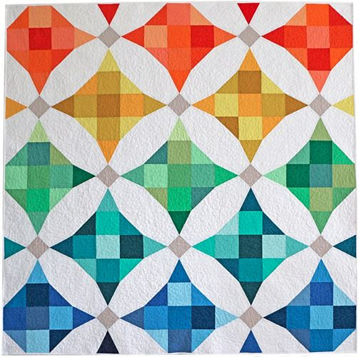 This simple but modern take on a classic pattern puts a fresh twist on nine-patch blocks. The illusion of curved piecing gives it interest, but it's really just