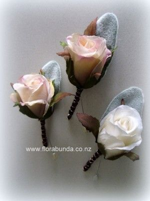 Blush pink vintage rose bud buttonhole with bound stem black and copper image