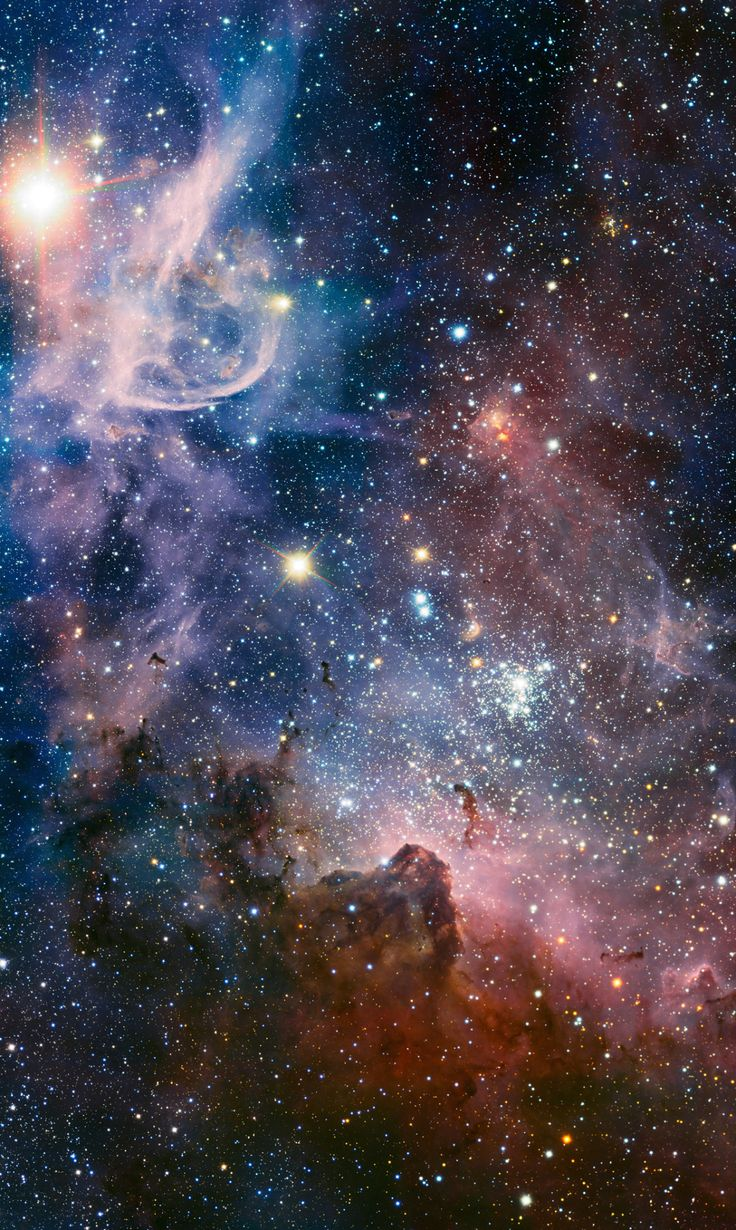 "The Wonders of the Carina Nebula  ""This broad image of the Carina Nebula, a region of massive star formation in the southern skies, was taken in infrared light using the HAWK-I camera on ESO's Very Large Telescope. Many previously hidden features, scattered across a spectacular celestial landscape of gas, dust and young stars, have emerged.""Credit: ESO/ESO top 100"
