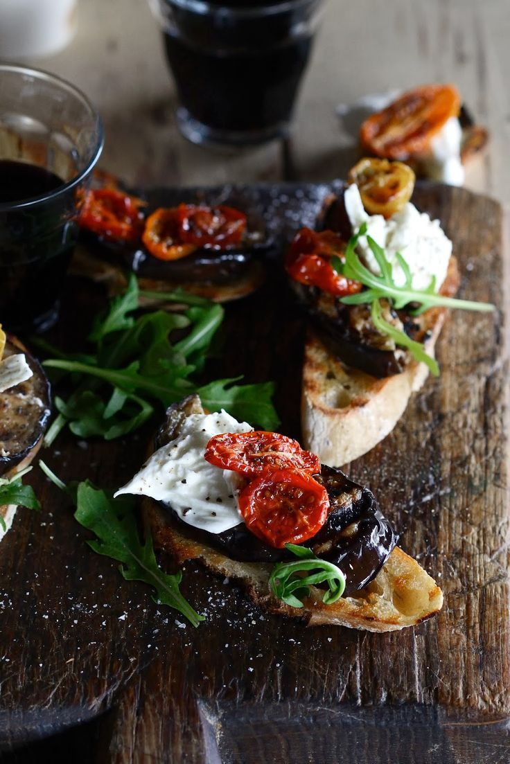 Bruschetta with grilled eggplant, slow-roasted tomatoes, burrata and rocket