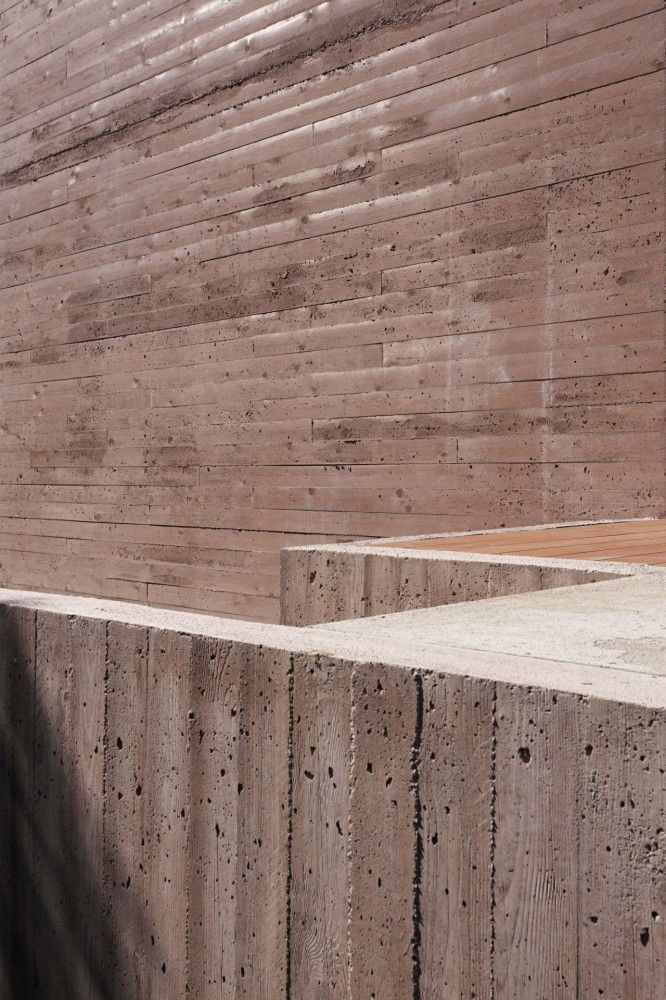 Rought formwork makes for beautiful concrete. House in Budapest by ZSK Architects. Photo: Tamás Bujnovszky.