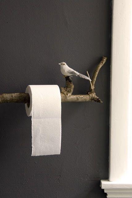 creative home decor.  Cutest TP holder as a bird & branch.