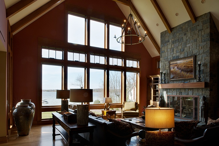 Living room with Pinnacle clad casement, awning, direct set, and swinging patio doors by Windsor Windows & Doors. www.windsorwindows.com