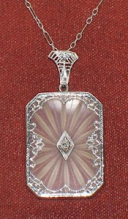 """Beautiful Antique Art Deco 14K Gold Camphor Glass Necklace set w/Diamond"" listed on Ebay by dshaw3. Click through for link to lot and a first-timer's guide to buying jewelry on Ebay by Diamonds in the Library."