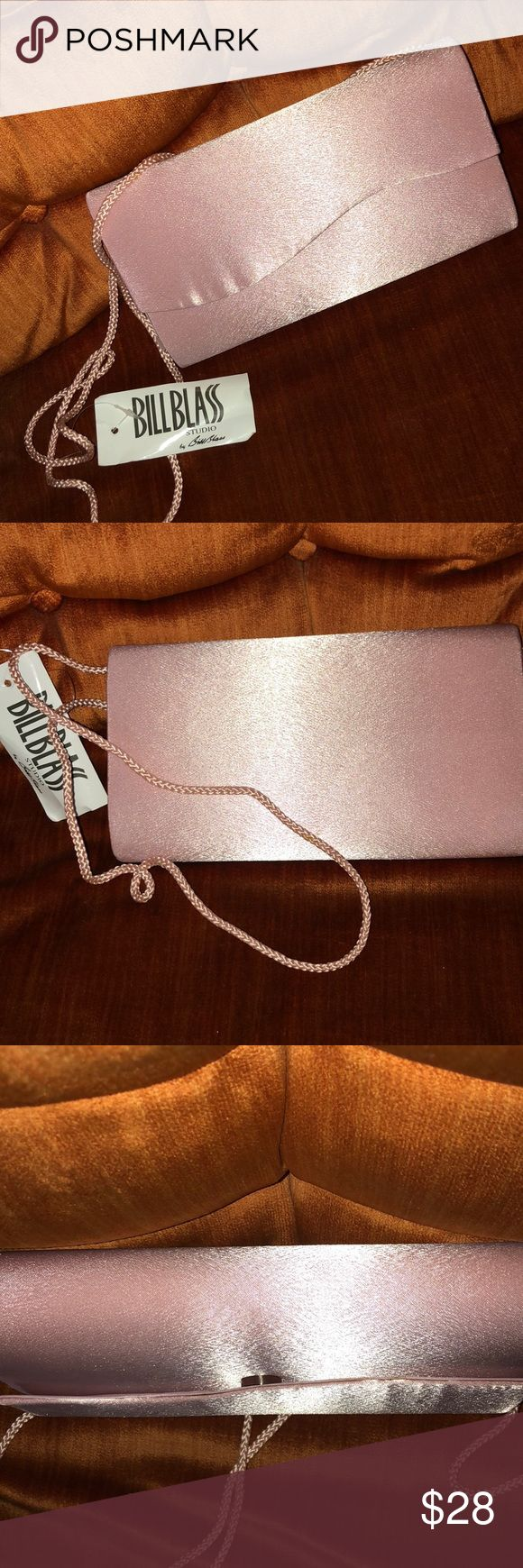 💜PINK CLUTCH PURSE💜 This romantic baby pink clutch bag can also be used as a shoulder bag with a pink cord  handle or leave it tucked in to go without. This vintage bag has been created from a beautiful satin there are no flaws other than a slight amount of puckering on the front which is not noticeable when worn. It has a silver magnet closure under front flap. Perfect bag for a wedding or prom. Very lightweight please see pics! Bill Blass Bags Clutches & Wristlets