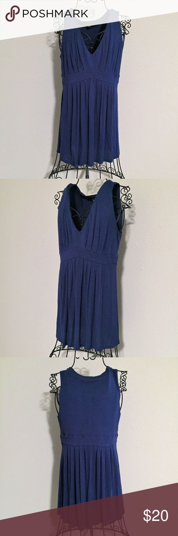BR V-Neck Sleeveless Top Great for layering! Pair this v-neck top with a neutral cami and head out in style! Navy v-neck, sleeveless top with flowy bodice.  EUC, Smoke Free Home Banana Republic Tops Tank Tops