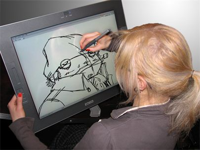 Animator animating on a Cintiq wacom tablet and Toon Boom Harmony