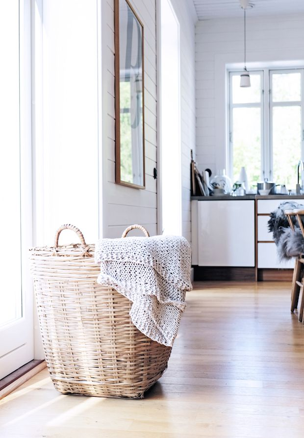 Baskter used as blanket storage in the beautiful home of Swedish interior  stylist Pella Hedeby.