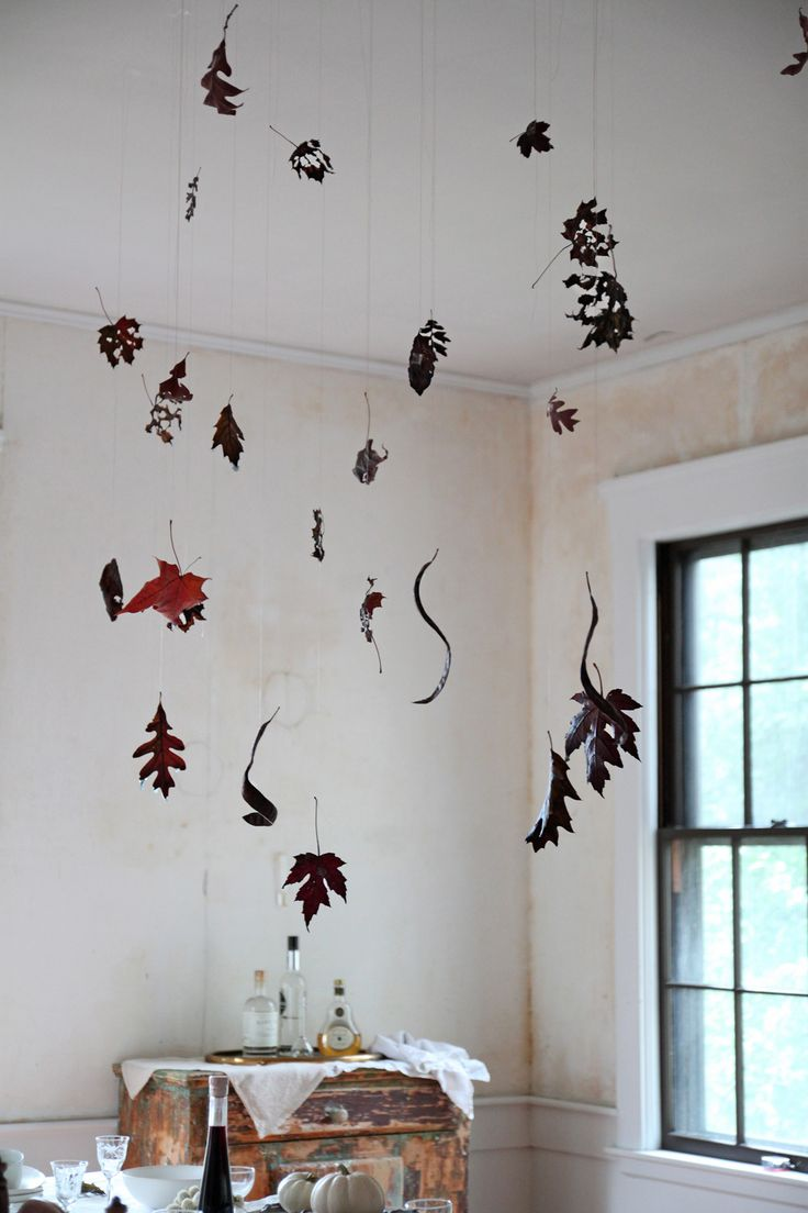 It would be nice to do something similar for xmas Halloween table with Black Leaves, leaf detail 1, by Justine Hand for Remodelista: