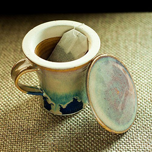 – This handmade Studio Pottery Filter Green Tea mug is handcrafted from Ceramic and decorated with a combination of glazes that gives it a wonderful, flowing look. – The mug has been glazed with celedon brown over the textured clay. – This Filter Green Tea Mug is designed in... see more details at https://bestselleroutlets.com/home-kitchen/kitchen-dining/dining-entertaining/cups-mugs-saucers/cup-saucer-sets/product-review-for-exclusivelane-handcrafted-studio