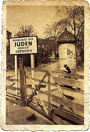 "Baluty district of Ldz, 1943. Ghetto Border. The sign reads: ""Jewish Quarter. Entry forbidden."""