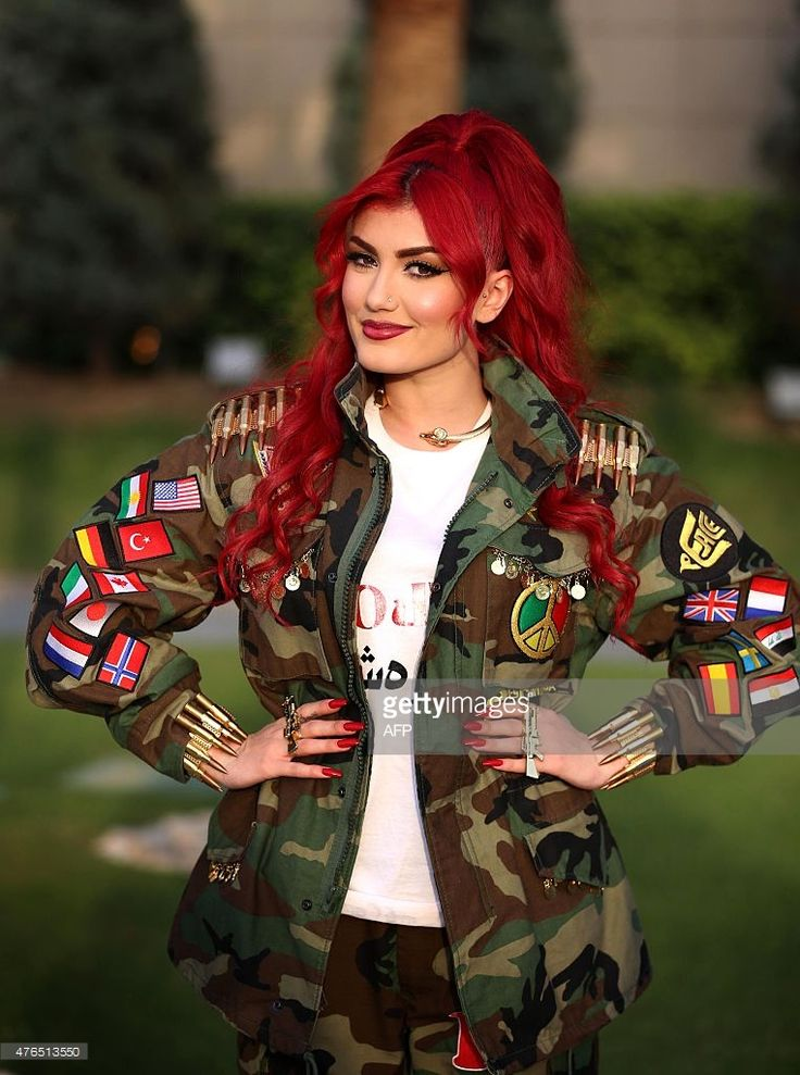 Iraqi Kurdish singer Helly Luv poses for a picture during an interview with AFP in Arbil, the capital of the autonomous Kurdish region of northern Iraq, on June 9, 2015. Luv is aiming for international fame as she releases her new English song Revolution', calling for action against terrorism and violence. AFP PHOTO / SAFIN HAMED
