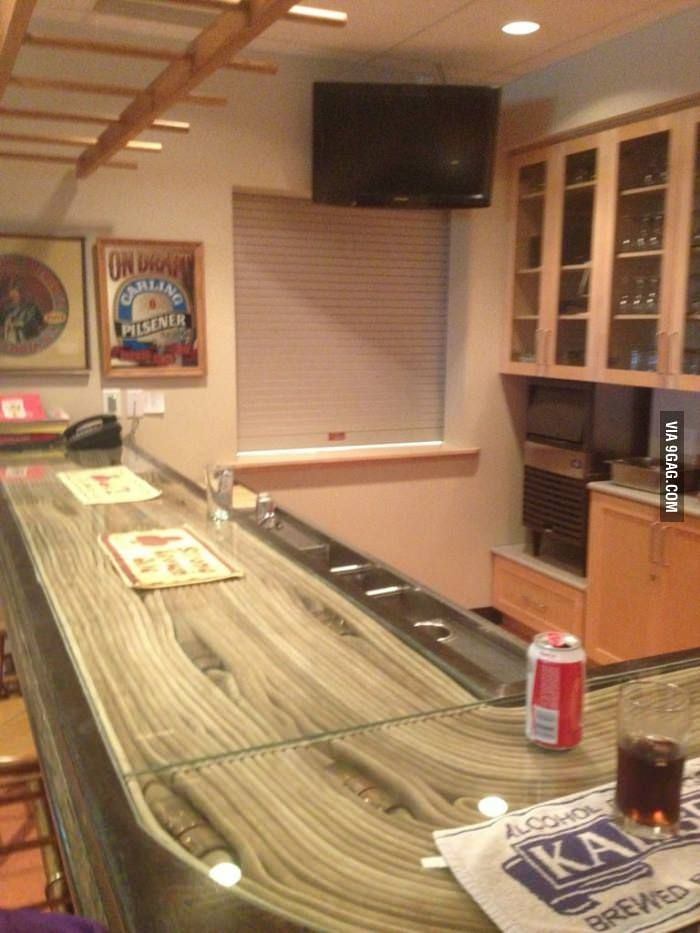 A fire station bar featuring an actual fire hose encased under glass.  | Shared by LION