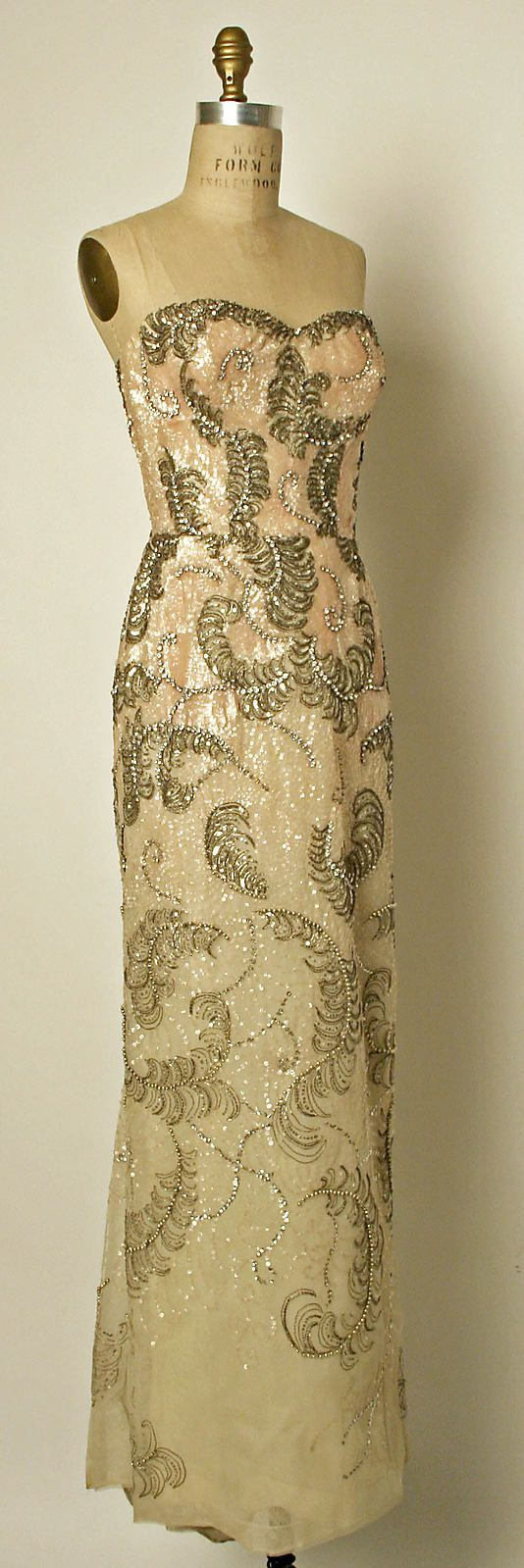 Pierre Balmain Haute Couture evening gown court presentation ensemble from 1953. Made from silk, cotton with embroidered glass bead, rhinestones pearl and sequin with flower floral embroidery in long dress strapless style with a matching stole. House of Balmain.