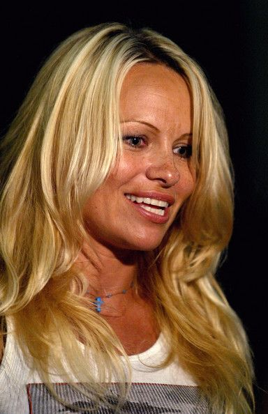 Pamela Anderson Photos Photos - Actress Pamela Anderson talks to reporters following the Women's finals of the U.S. Gymnastics Olympic Team Trials on June 27, 2004 at The Arrowhead Pond of Anaheim in Anaheim, California.  Anderson is sponsoring the training of gymnast Mohini Bhardwaj. - U.S. Olympic Team Trials Gymnastics Day 4