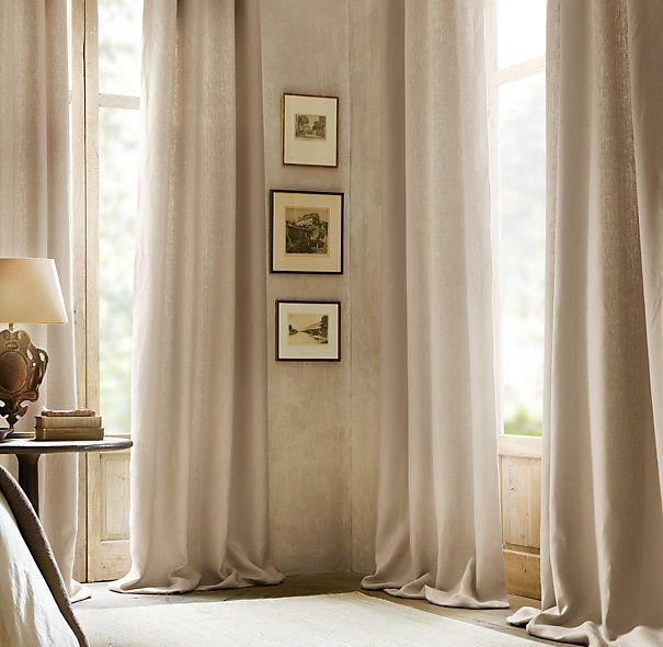 This cream drapery, which shows the lining, adds a classy feel to this nuetral room. I really like the curtains becuase they add a calming feel to the room because they are cascadeing.