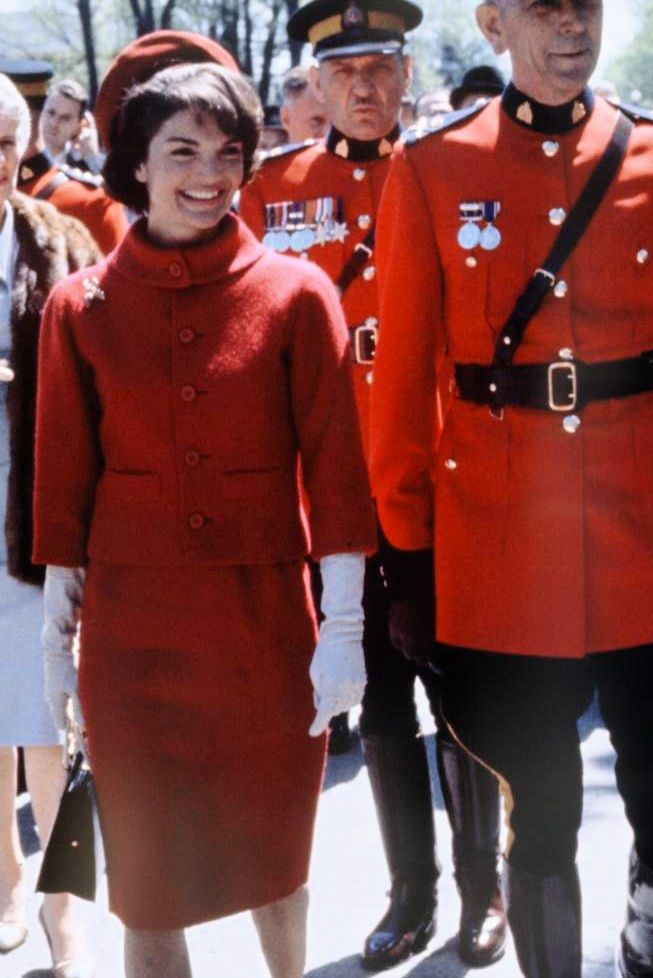 First Lady Jacqueline Kennedy on a visit to Canada. Stylish in red.
