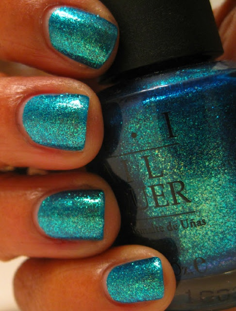 OPI Catch Me In Your Net. What a lovely name for this turquoise with gold and green glassfleck polish. I have heard that it is now in the HTF Hall Of Fame
