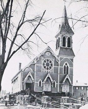 St. James Church being moved to its current location by tractor.