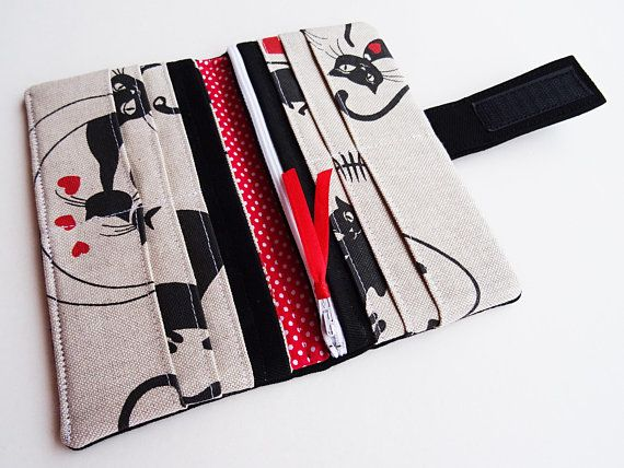This beautiful Vegan Wallet is made with cotton fabric. Most phones will fit also. For more strength this wallet is wadding with soft vinyl fabric inside. FABRIC: Main fabric and lining – microfiber, cotton, polyester, velkro tape Soft vinyl fabric wadding Satin ribbon  SIZE: = when open: