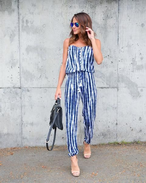 Our Tropez DrawstringJumpsuit is adorable in this spaghetti strapsilhouette and blue tie dye print with a drawstring waist. The pants cuff in elastic to creat