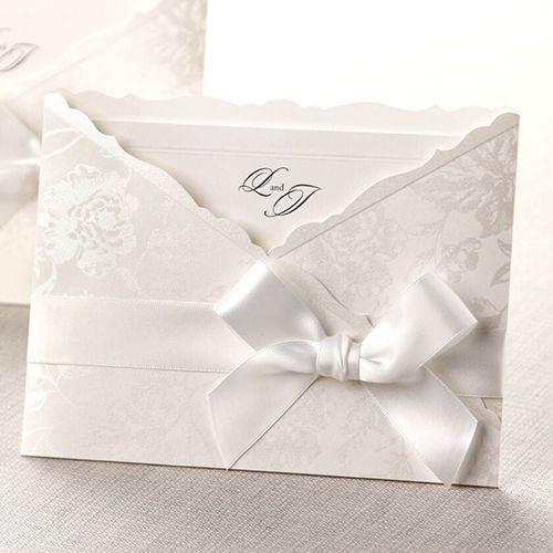 Elegant floral pocket that glistens with a silk finish.  Classic white bordered invitation just slips in.  @bwedding #wedding #weddinginvitations