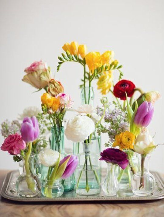 15 Centerpieces For Your Summer Table - Put them all on a tray. Genius!