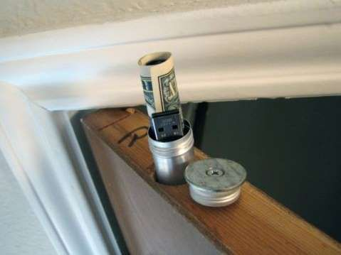 A cigar tube finds a clever new use within a hollow door. Stash emergency cash or an important flash... - Make