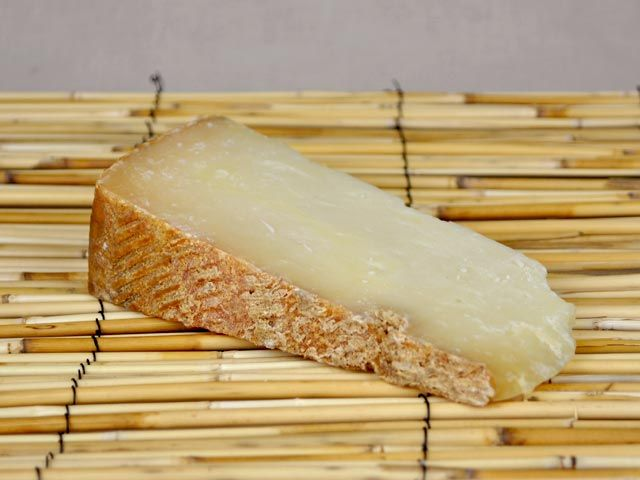 Pecorino Caggiano     Country of Origin: Italy  Region: Basilicata  City / Village: Forenza  Type of Milk: Sheep  Cheese Style: Hard  Flavor Profile: Medium-strong