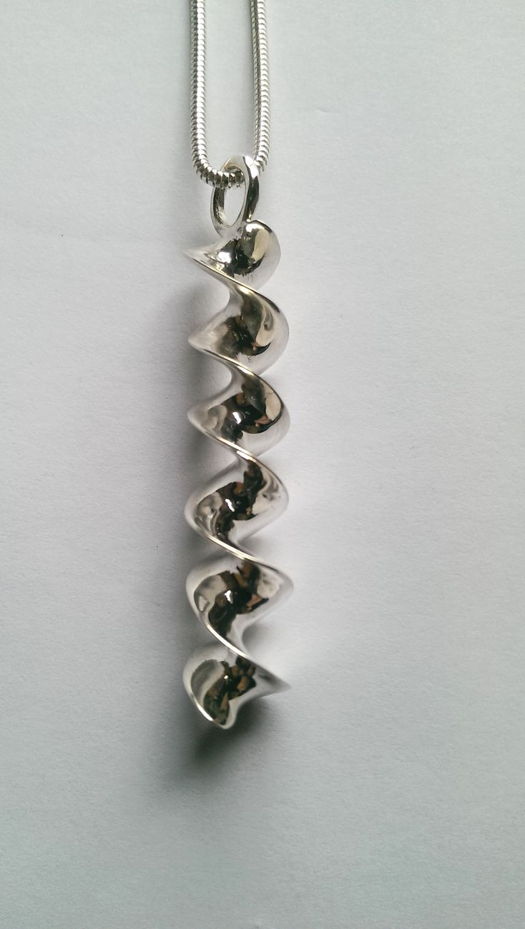 Silver Ribbon Torc long pendant and chain.