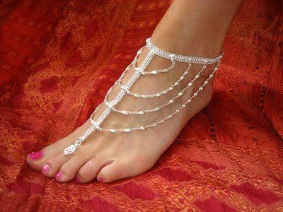 An anklet  (in Arabic: خلخال), ankle chain, or ankle bracelet, is an ornament  worn around the ankle . Barefoot anklets and toe rings  histo...