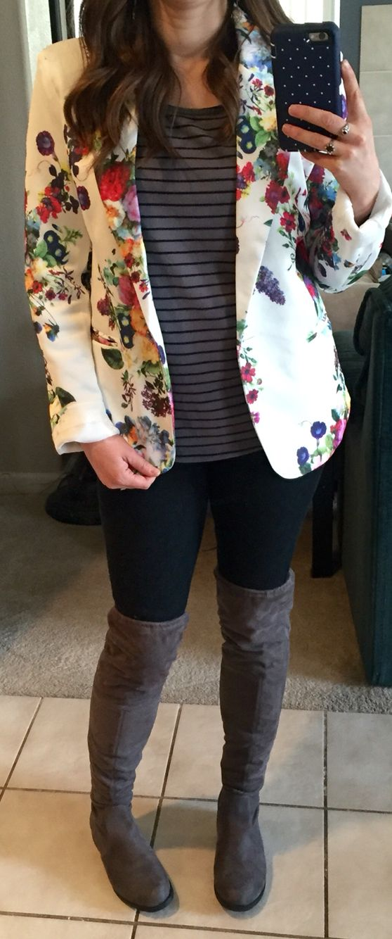Floral blazer, grey and black striped shirt, black jeans, grey over-the-knee boots.